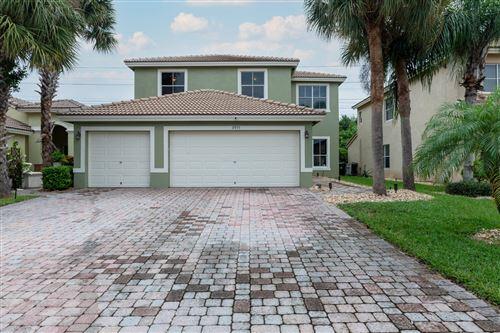 Photo of 3975 Torres Circle, West Palm Beach, FL 33409 (MLS # RX-10754717)