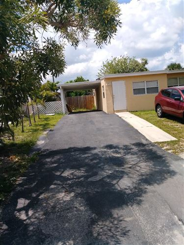 Photo of 391 Ficus Tree Drive, Lake Worth, FL 33462 (MLS # RX-10672718)