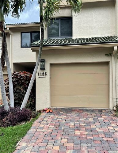 Photo of 1125 Boca Cove Lane, Highland Beach, FL 33487 (MLS # RX-10724723)