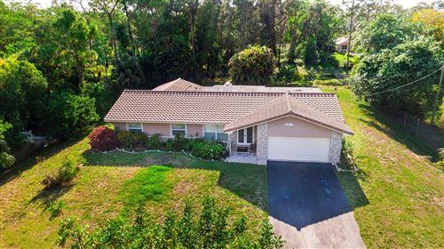 Photo of 5909 NW 71st Terrace, Parkland, FL 33067 (MLS # RX-10705729)