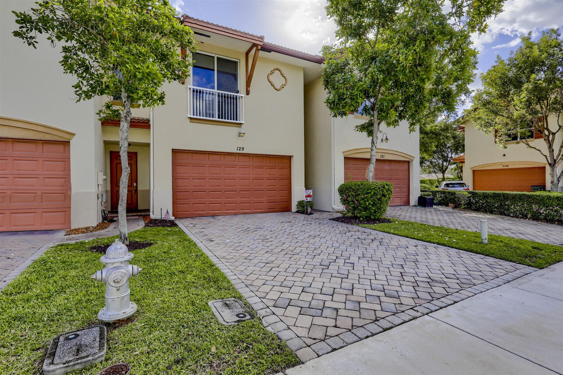 Photo of 129 E Prive Circle, Delray Beach, FL 33445 (MLS # RX-10753731)