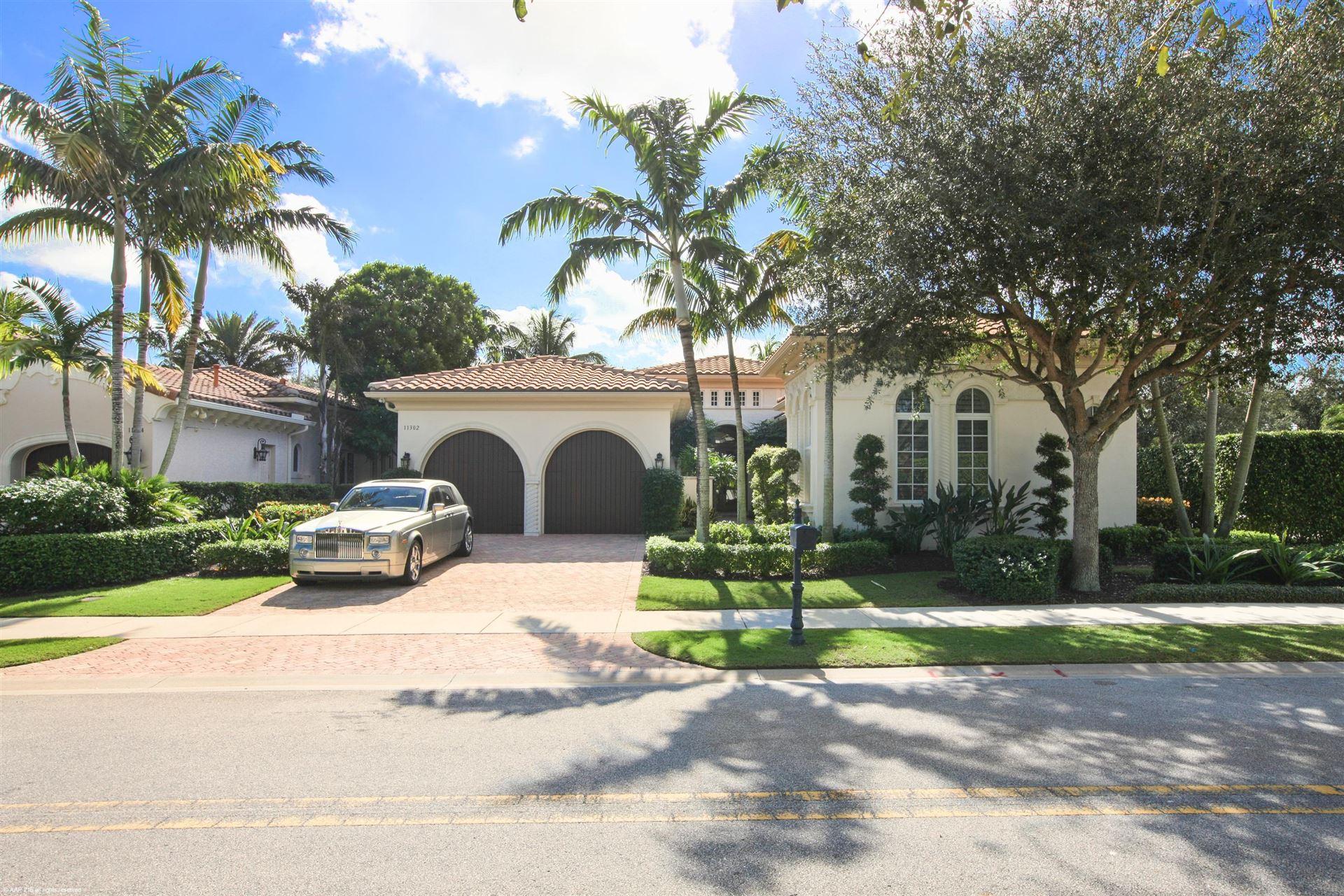 Photo of 11302 Caladium Lane, Palm Beach Gardens, FL 33418 (MLS # RX-10611732)