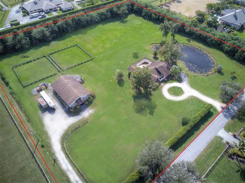 Photo of 15410 Palma Lane, Wellington, FL 33414 (MLS # RX-10506742)