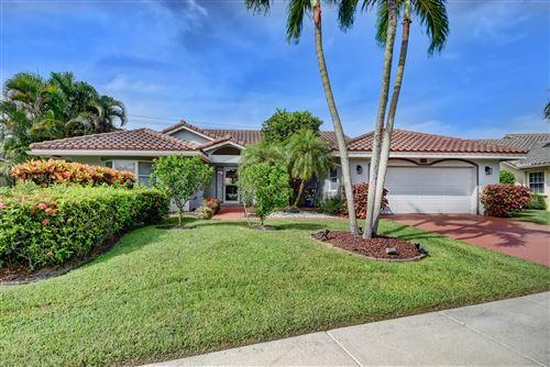 Photo of 6116 Golf Villas Drive, Boynton Beach, FL 33437 (MLS # RX-10637744)