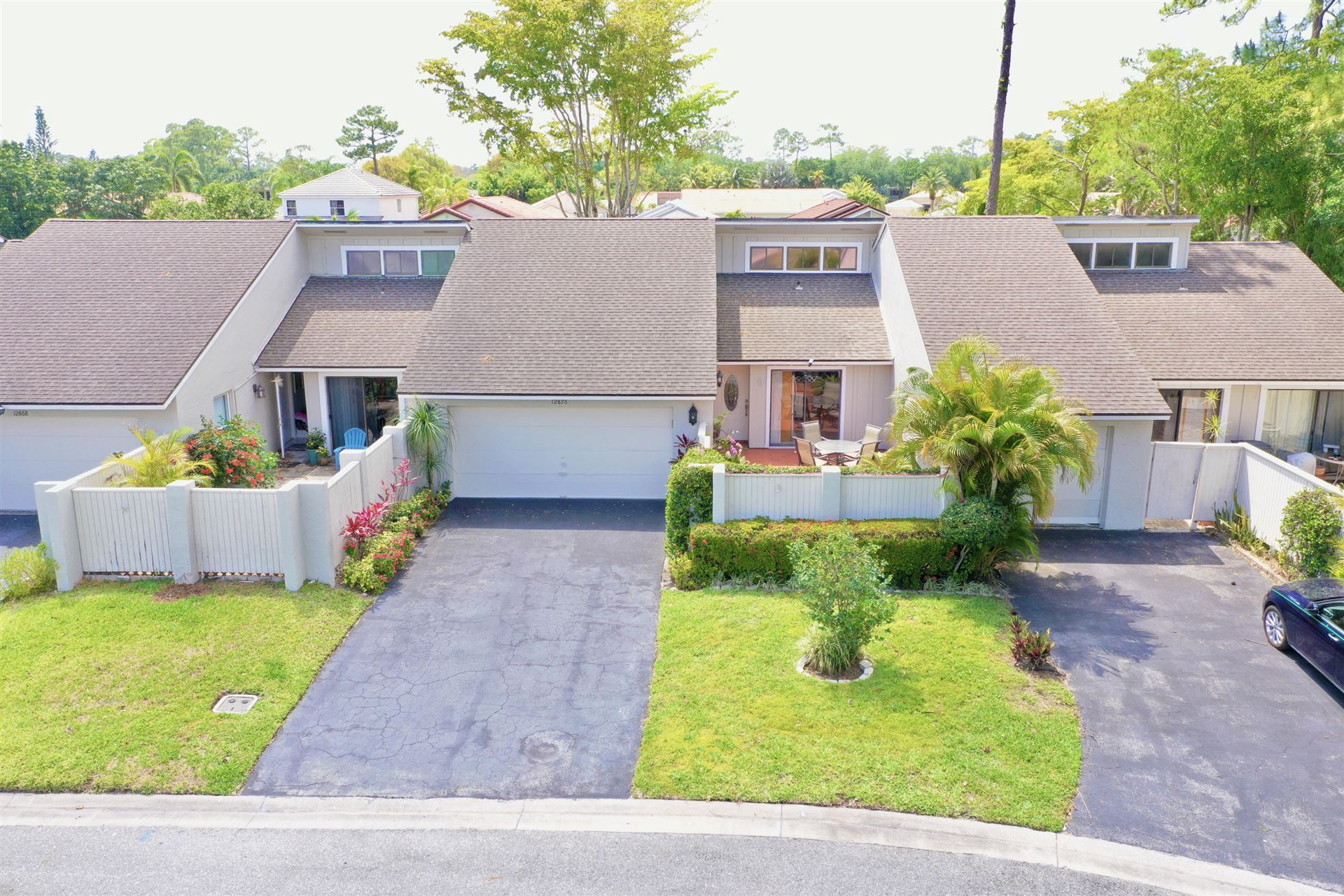 Photo of 12876 Spinnaker Lane, Wellington, FL 33414 (MLS # RX-10709750)