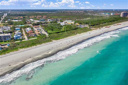 Photo of 541 Saturn Lane, Juno Beach, FL 33408 (MLS # RX-10693751)