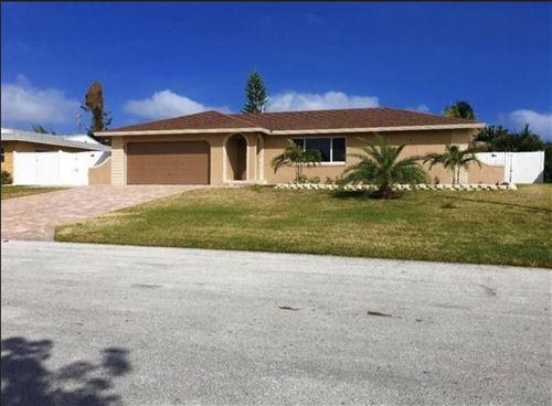Photo of 4890 NW 5th Terrace, Boca Raton, FL 33431 (MLS # RX-10706754)