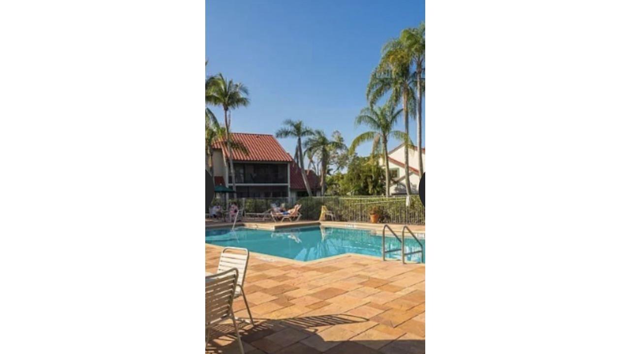 Photo of 6 Lexington Lane #B, Palm Beach Gardens, FL 33418 (MLS # RX-10723754)
