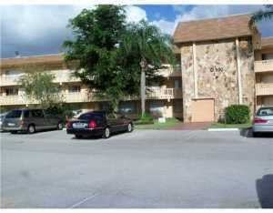 Photo of 500 Village Green 105 Circle W #105, Palm Springs, FL 33461 (MLS # RX-10709756)
