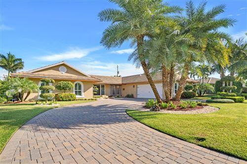 Photo of 212 Gleneagles Drive, Atlantis, FL 33462 (MLS # RX-10747757)