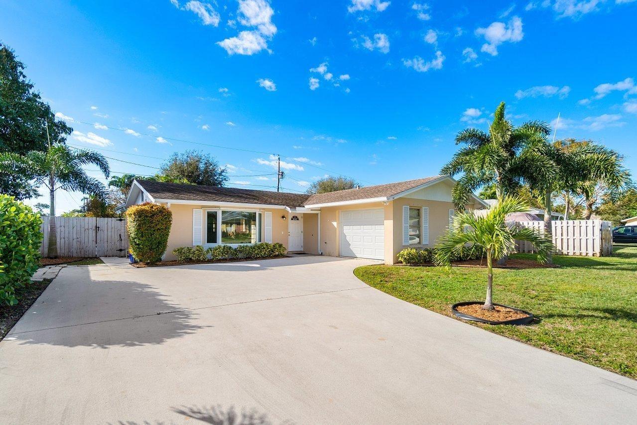 Photo of 3912 Flag Drive, Palm Beach Gardens, FL 33410 (MLS # RX-10686758)