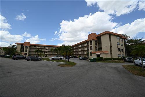 Photo of 6061 N Falls Circle Drive #102, Lauderhill, FL 33319 (MLS # RX-10708759)