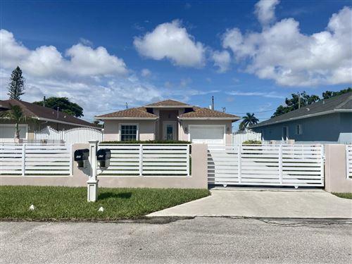 Photo of 625 Mercury St, West Palm Beach, FL 33406 (MLS # RX-10745770)