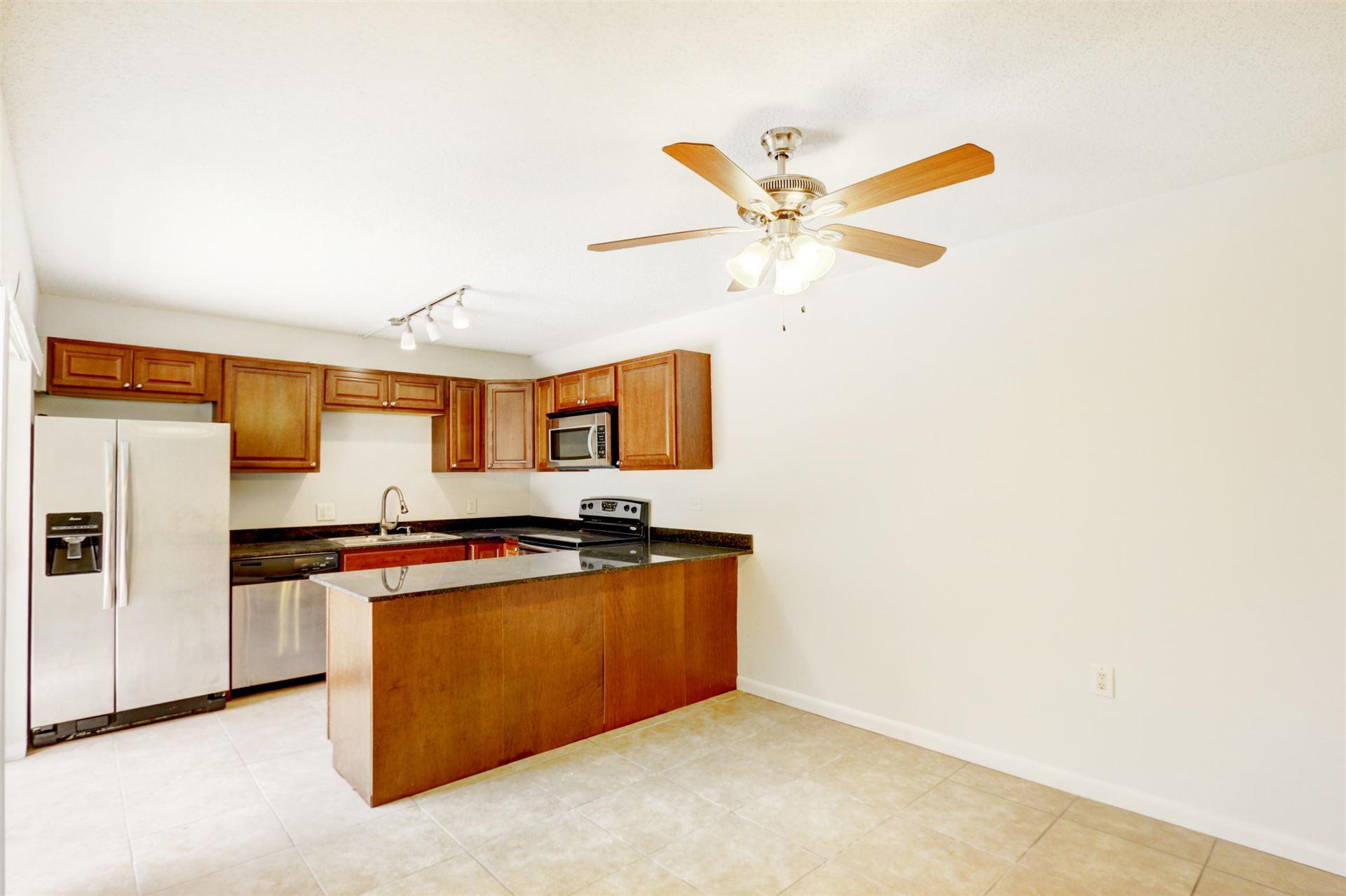 Photo of 1011 10th Terrace, Palm Beach Gardens, FL 33418 (MLS # RX-10643770)