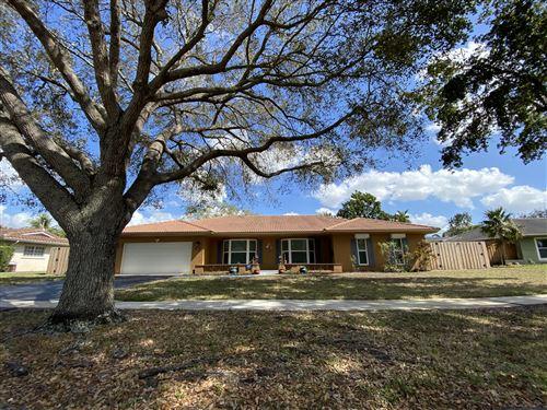 Photo of 810 NW 73rd Avenue, Plantation, FL 33317 (MLS # RX-10689771)