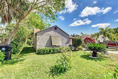 Photo of 630 S Pine Street, Lake Worth Beach, FL 33460 (MLS # RX-10696771)
