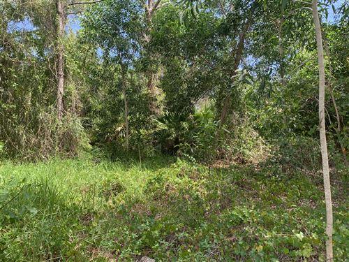 Photo of 5469 NW Boydga Avenue, Port Saint Lucie, FL 34986 (MLS # RX-10735771)