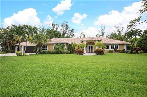 Photo of 22180 Woodset Lane, Boca Raton, FL 33428 (MLS # RX-10646772)