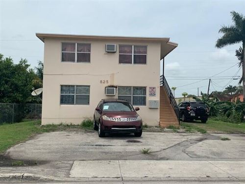 Photo of 825 SW Avenue C Place, Belle Glade, FL 33430 (MLS # RX-10726776)