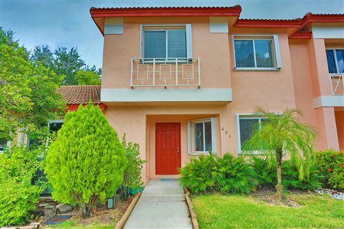 Photo of 673 NW 208th Terrace, Pembroke Pines, FL 33029 (MLS # RX-10745781)