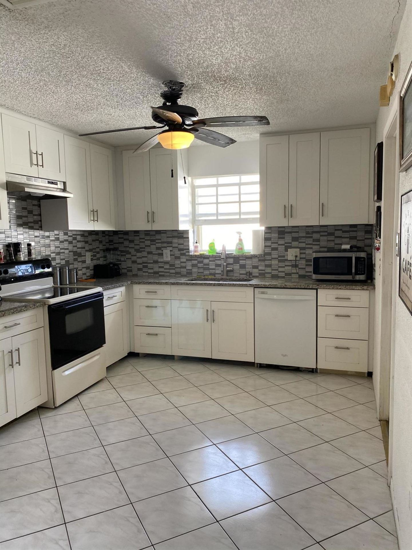 Photo of 22335 Boulder Street, Boca Raton, FL 33428 (MLS # RX-10685783)