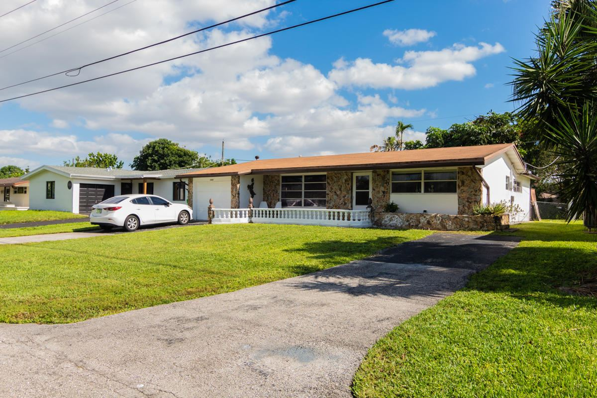 Photo of 2590 N Pine Island Road, Sunrise, FL 33322 (MLS # RX-10672784)