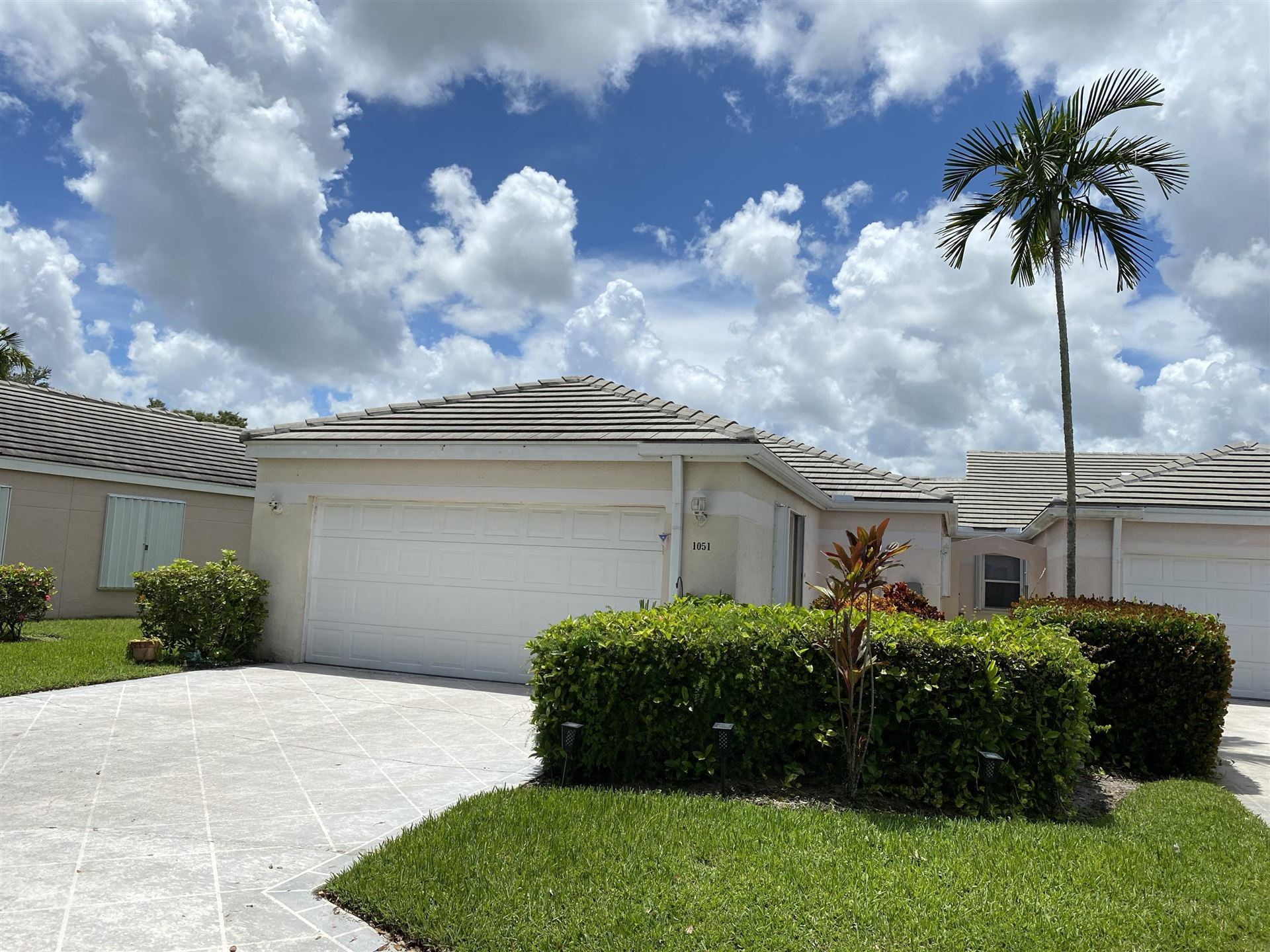 Photo of 1051 Island Manor Drive, Greenacres, FL 33413 (MLS # RX-10646785)