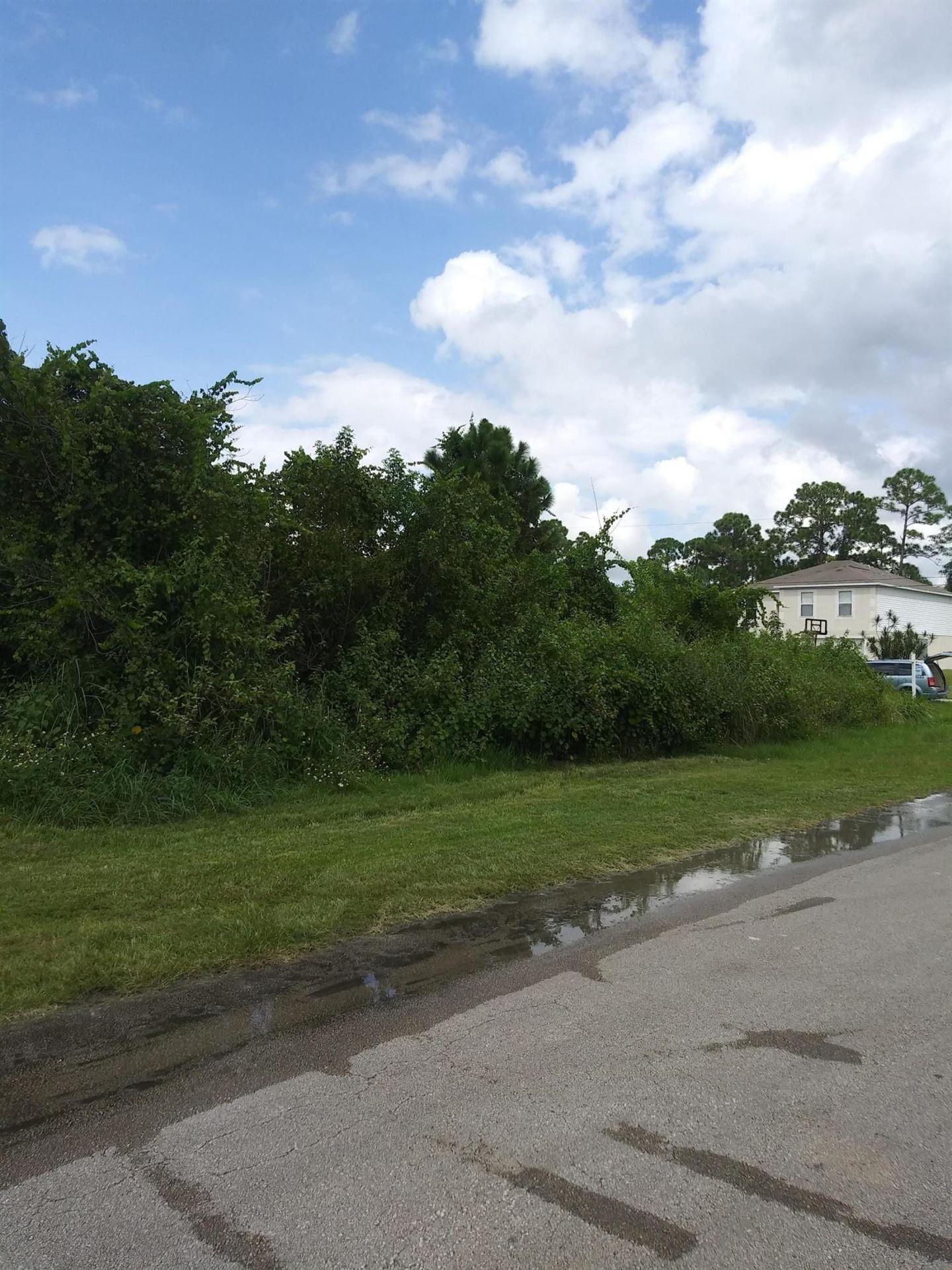 Photo of 3662 SW Europe Street, Port Saint Lucie, FL 34953 (MLS # RX-10656786)