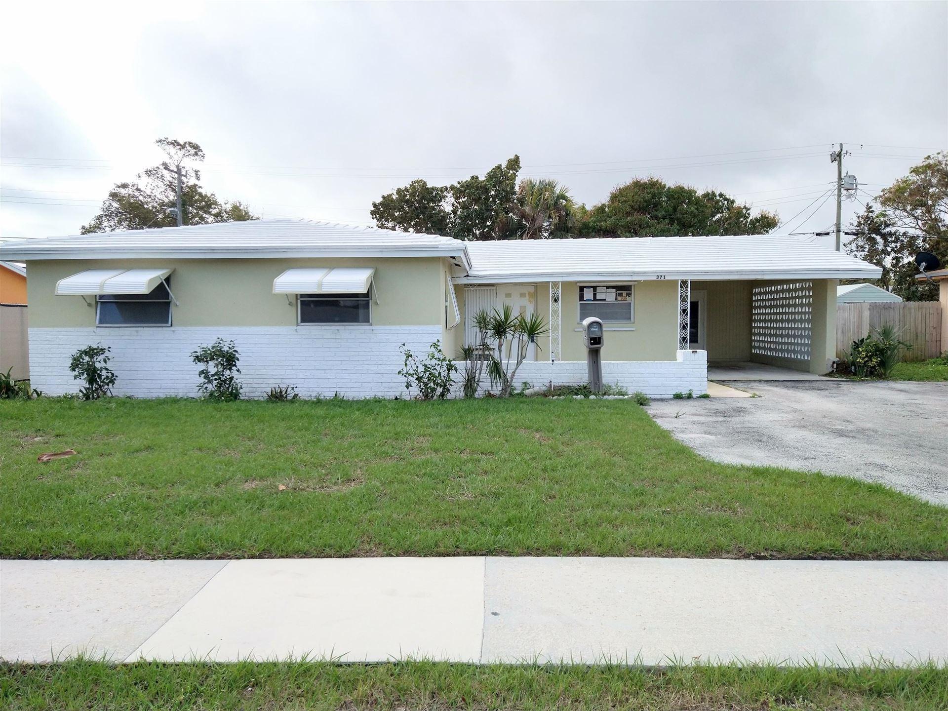 Photo of 371 W 30th Street, Riviera Beach, FL 33404 (MLS # RX-10694787)