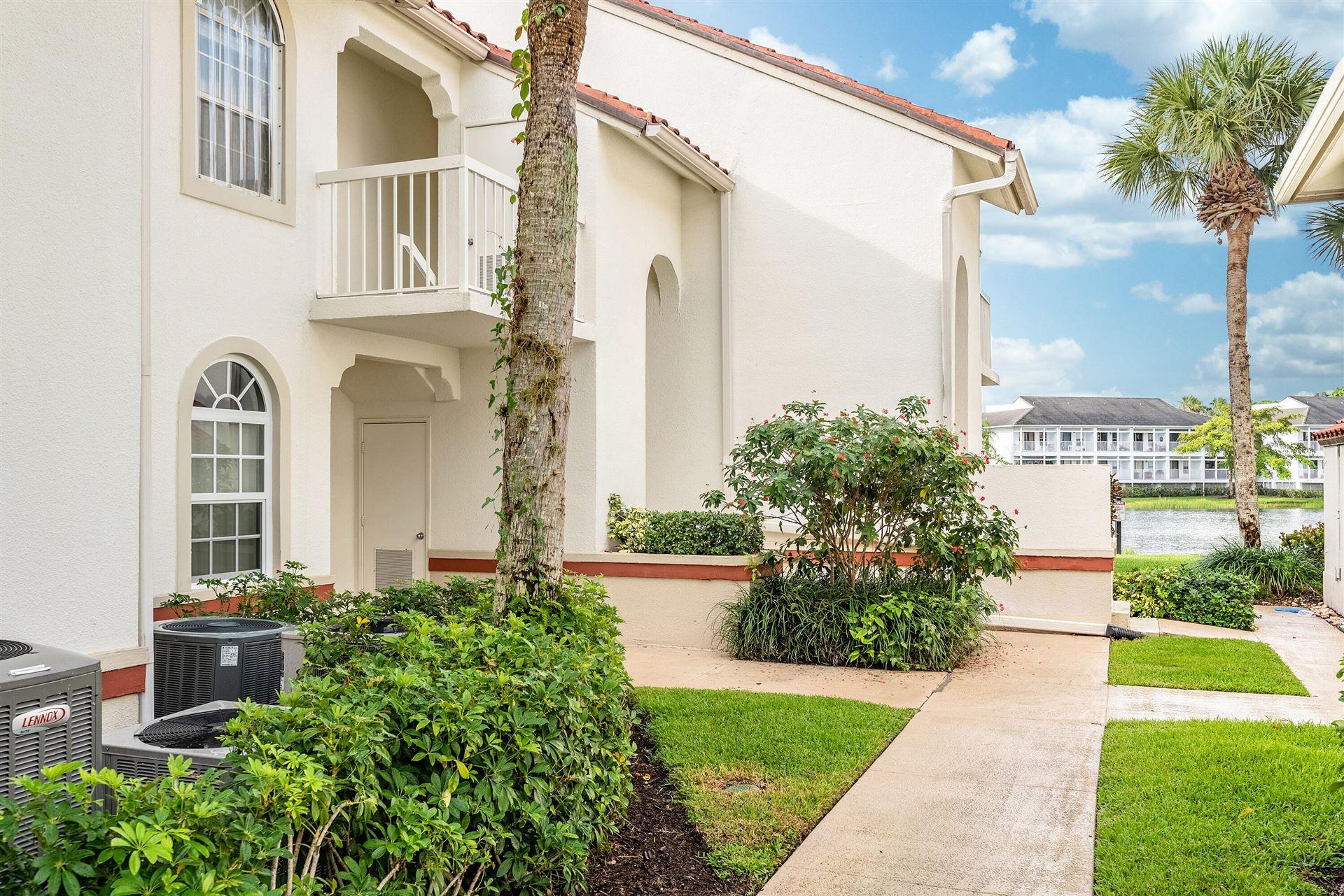 Photo of 213 Cypress Point Drive, Palm Beach Gardens, FL 33418 (MLS # RX-10728789)