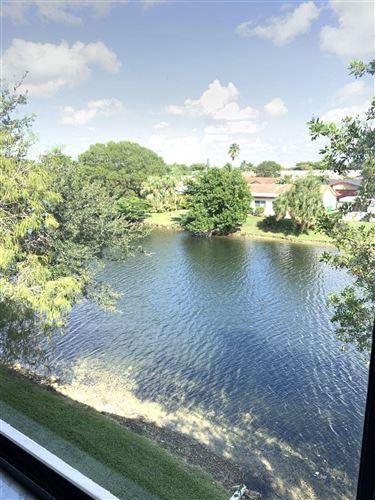Photo of 9493 N Belfort Circle #304, Tamarac, FL 33321 (MLS # RX-10665795)