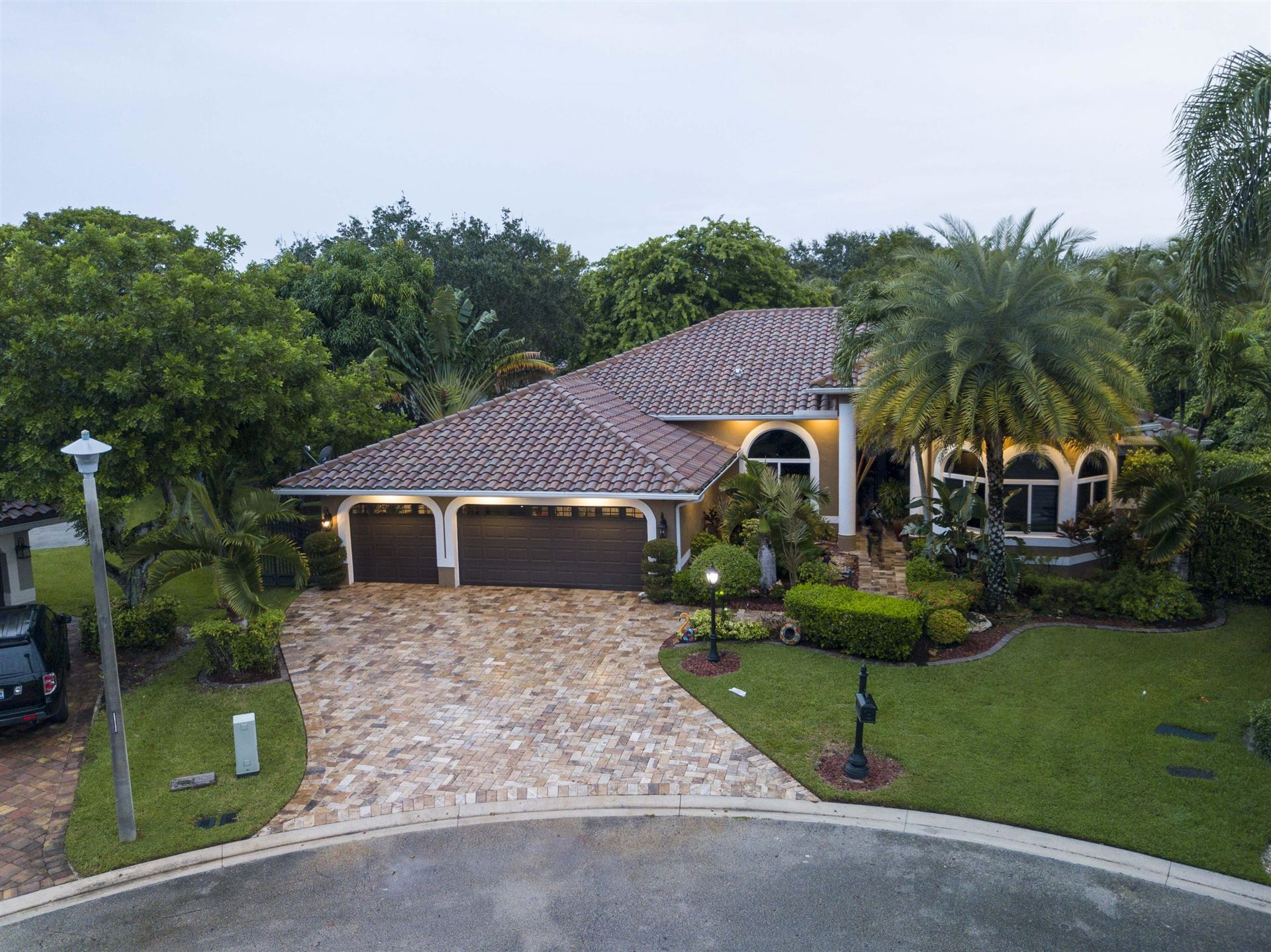 Photo of 10171 NW 59th Drive, Parkland, FL 33076 (MLS # RX-10670798)
