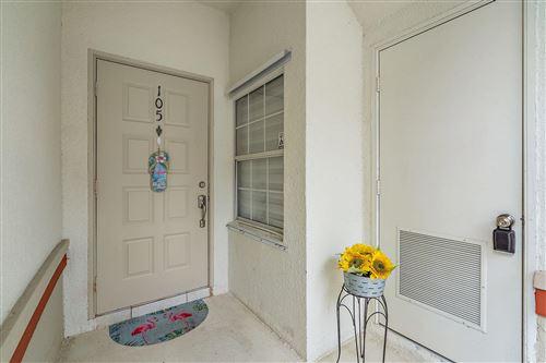 Photo of 105 Cypress Point Drive, Palm Beach Gardens, FL 33418 (MLS # RX-10627799)