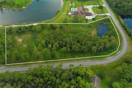 Photo of 6330 Wild Orchid Trail, Lake Worth, FL 33449 (MLS # RX-10743803)