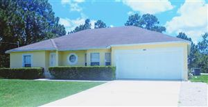 Photo of 5816 NW Erin Avenue, Port Saint Lucie, FL 34986 (MLS # RX-10523804)
