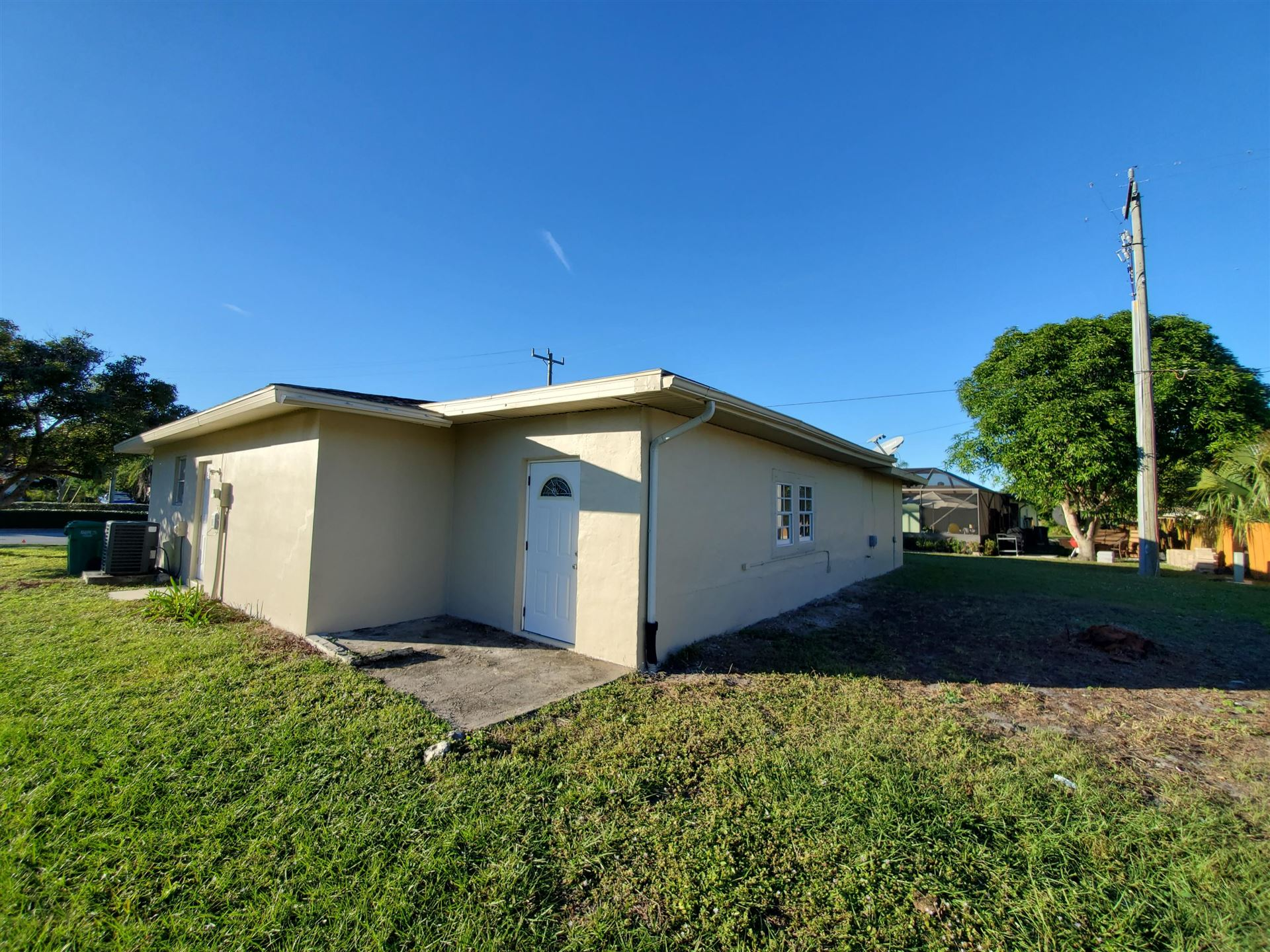 Photo of 153 NE Airoso Boulevard, Port Saint Lucie, FL 34986 (MLS # RX-10685804)