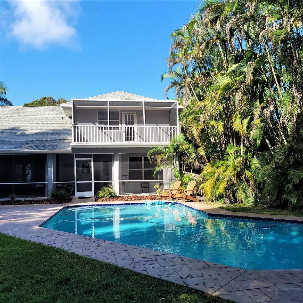 Photo of 233 NE Treebine Terrace, Jensen Beach, FL 34957 (MLS # RX-10666805)