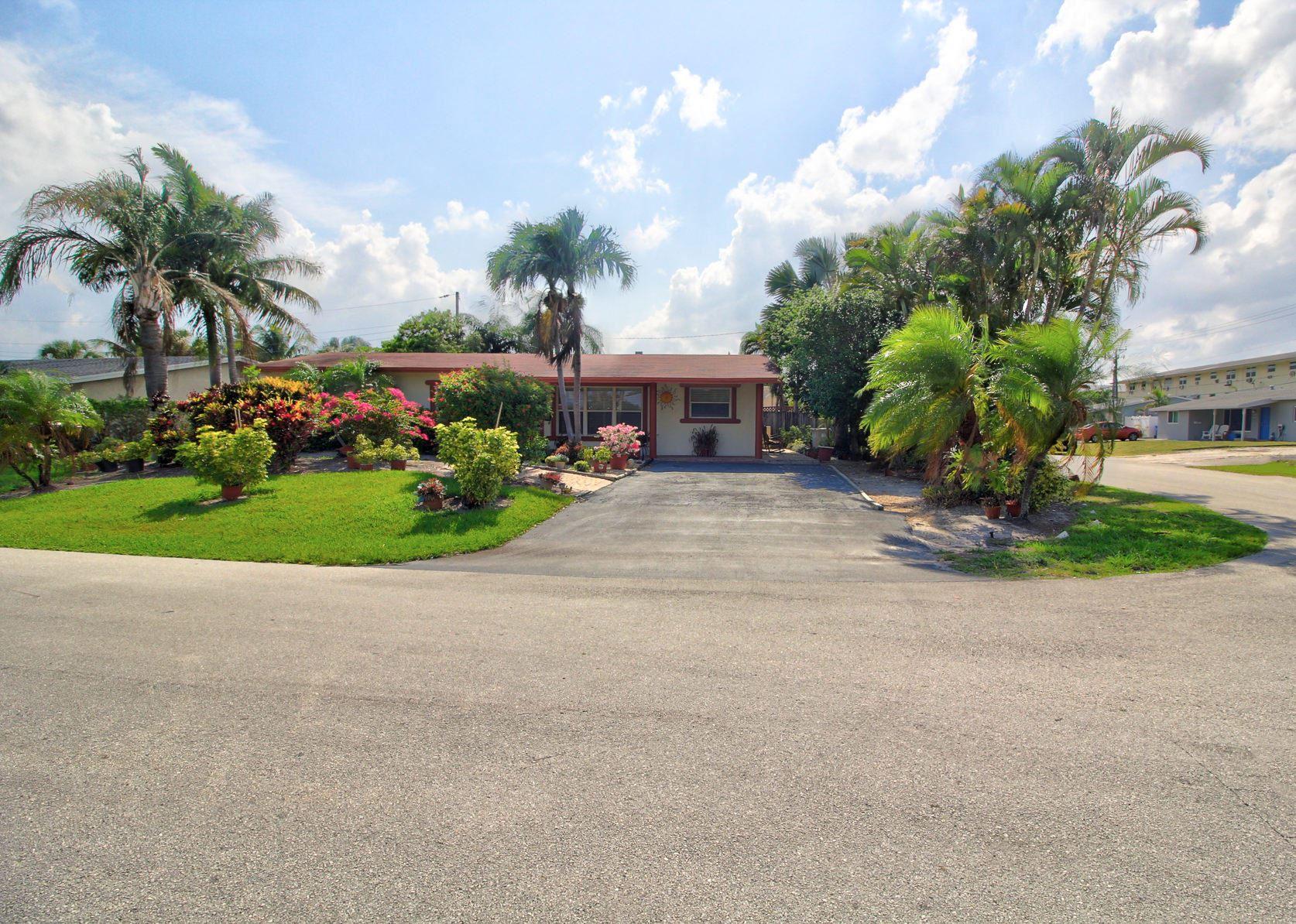 Photo of 3451 NE 14th Terrace, Pompano Beach, FL 33064 (MLS # RX-10714805)