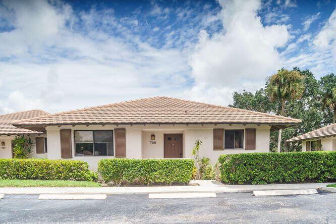 Photo of 708 Club Drive, Palm Beach Gardens, FL 33418 (MLS # RX-10745807)