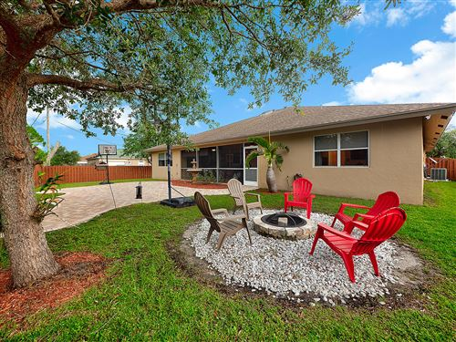 Photo of 2372 SW Vale Street, Port Saint Lucie, FL 34953 (MLS # RX-10626808)