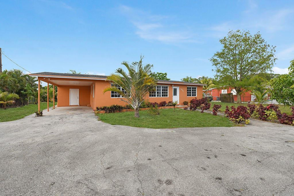 Photo of 5835 Lime Road, West Palm Beach, FL 33413 (MLS # RX-10708808)