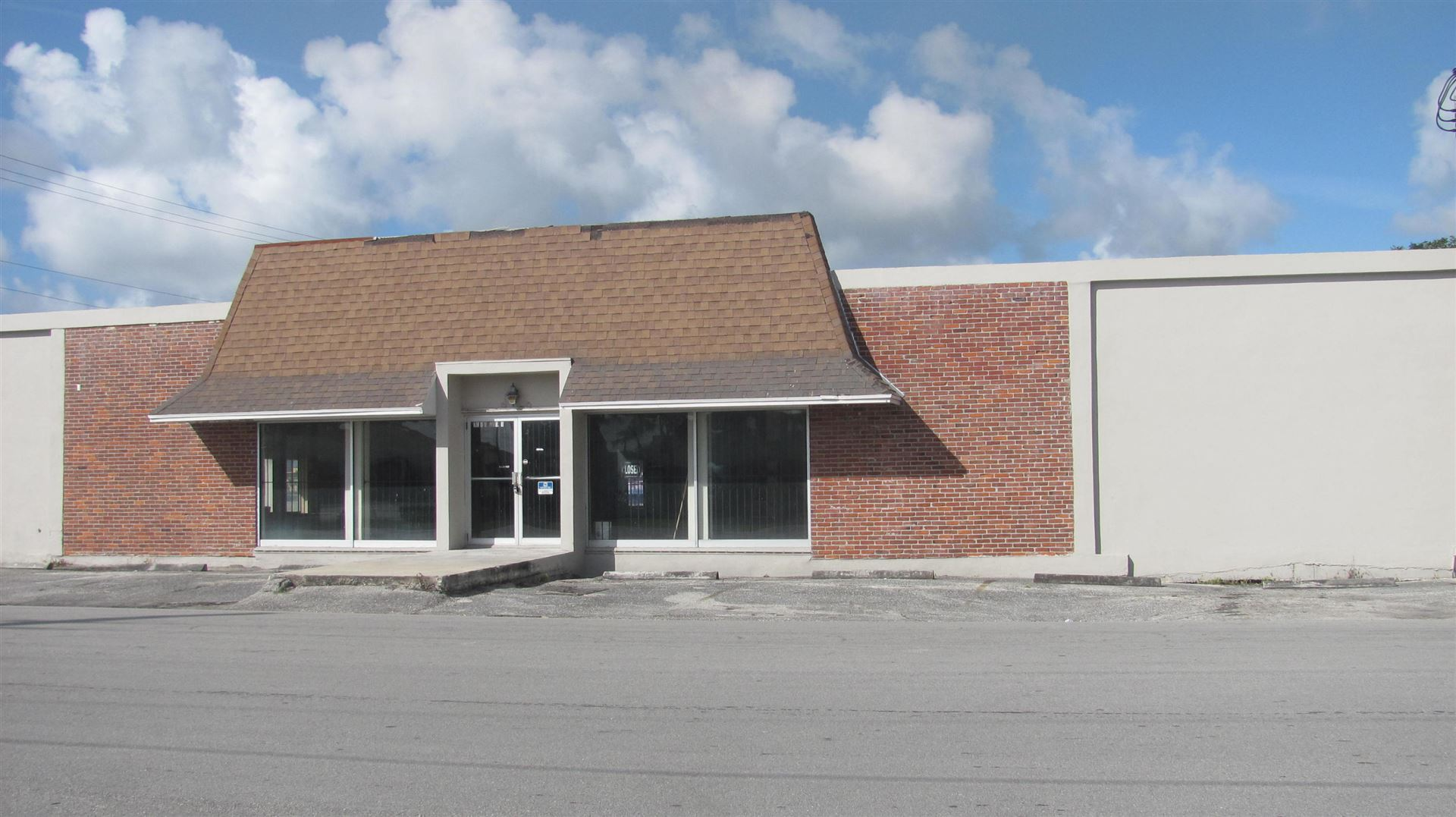 Photo of 73 Dr Martin Luther King Jr Boulevard E, Belle Glade, FL 33430 (MLS # RX-10632811)