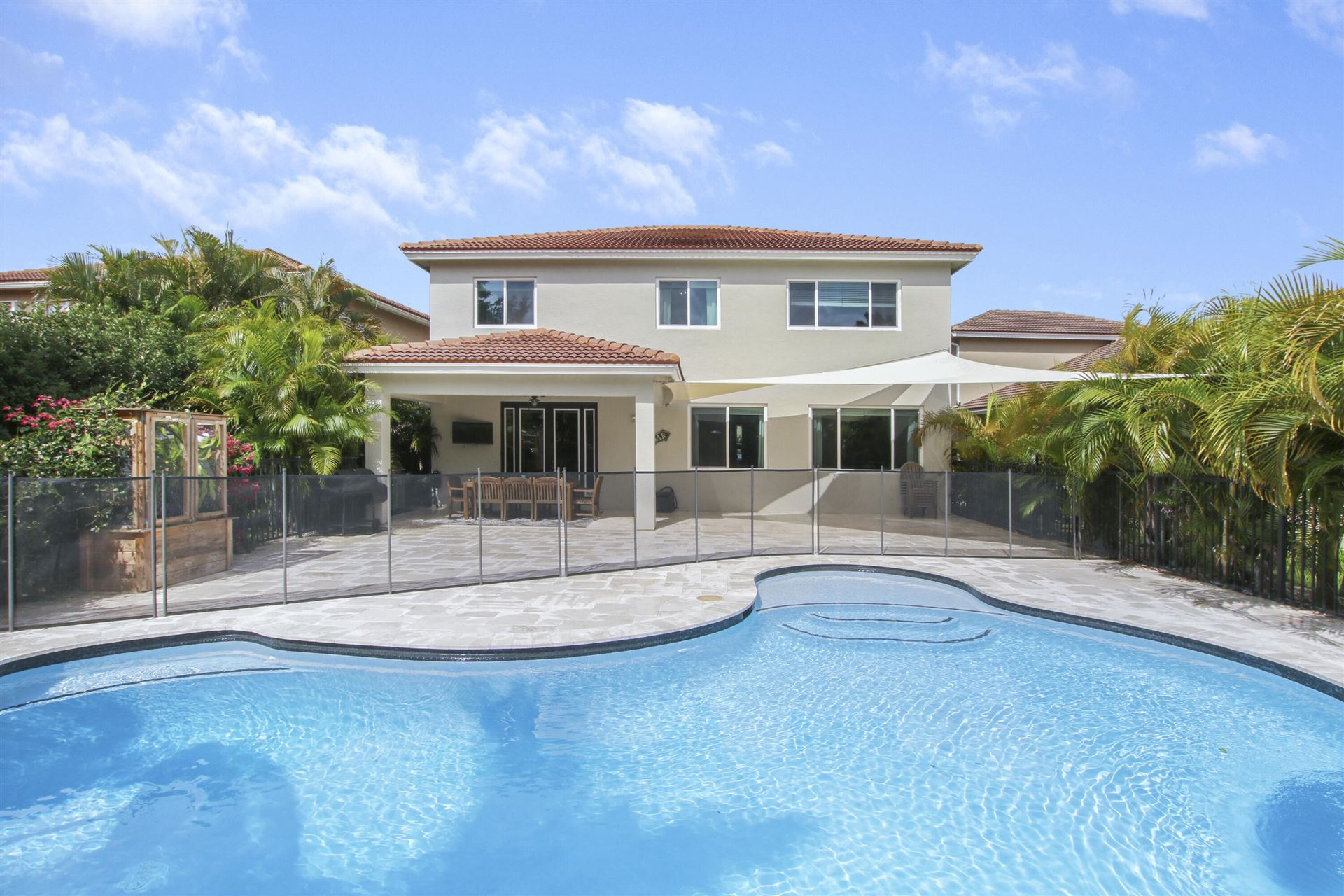 Photo of 6043 SW Bald Eagle Drive, Palm City, FL 34990 (MLS # RX-10717814)