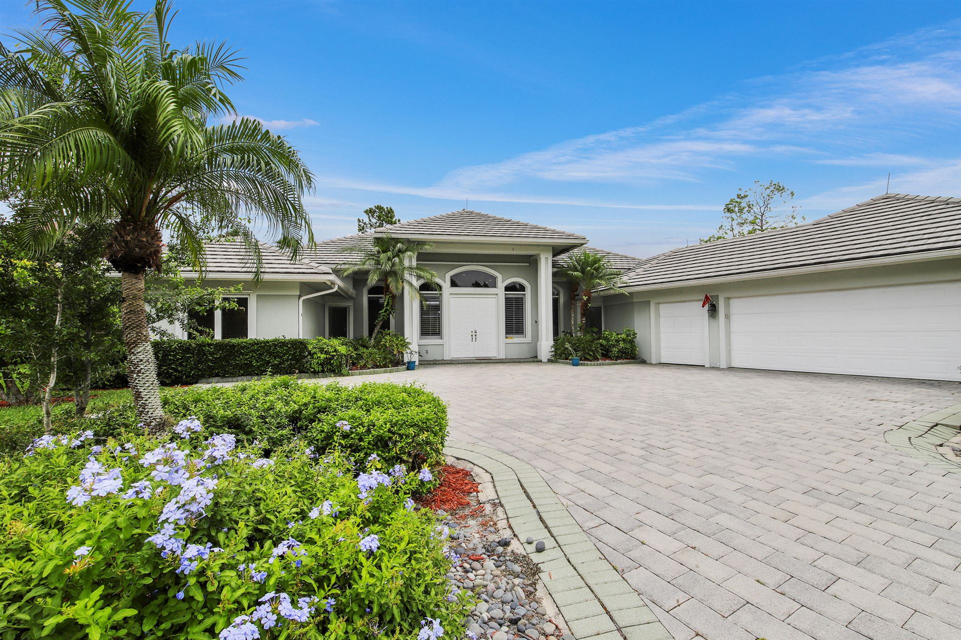 Photo of 284 SW Squire Johns Lane, Palm City, FL 34990 (MLS # RX-10627815)