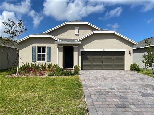 Photo of 1353 NE White Pine Terrace, Ocean Breeze, FL 34957 (MLS # RX-10613816)