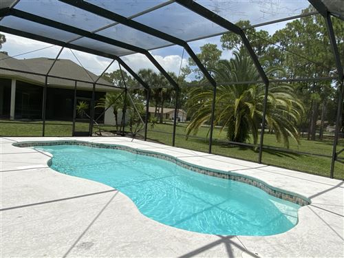 Photo of 13926 Temple Boulevard, West Palm Beach, FL 33412 (MLS # RX-10637819)