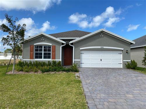 Photo of 1343 NE White Pine Terrace, Ocean Breeze, FL 34957 (MLS # RX-10613820)