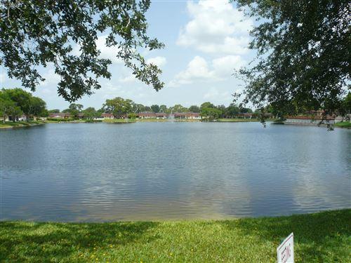 Photo of 544 Franconia Circle #B, Lake Worth, FL 33467 (MLS # RX-10634823)