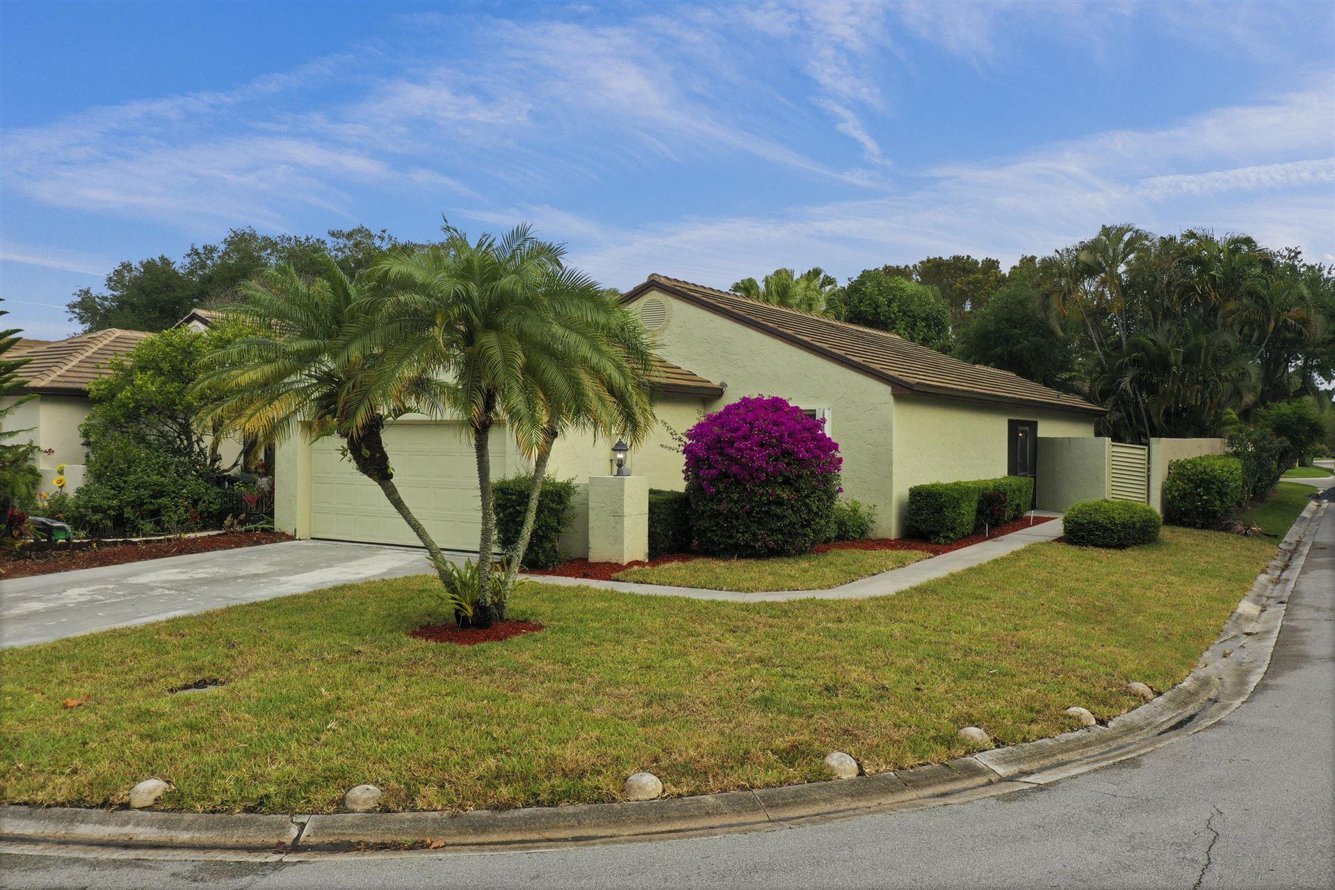 Photo of 54 Ironwood Way N, Palm Beach Gardens, FL 33418 (MLS # RX-10709826)