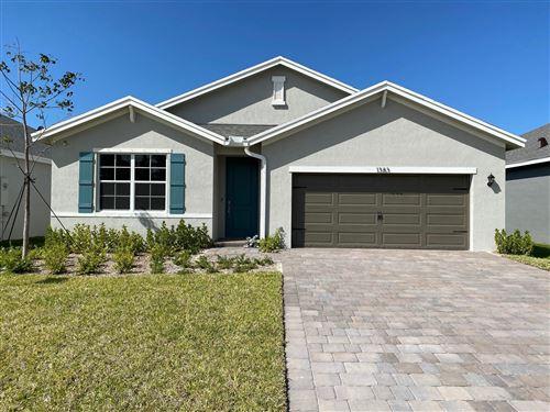 Photo of 1383 NE White Pine Terrace, Ocean Breeze, FL 34957 (MLS # RX-10613827)